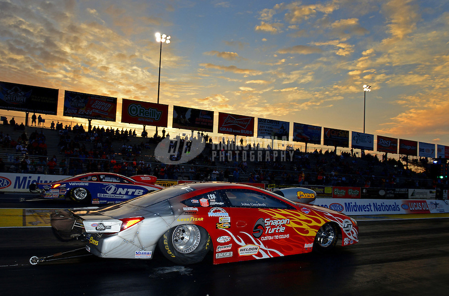 Sept. 28, 2012; Madison, IL, USA: NHRA pro stock driver John Gaydosh (near lane) races alongside Shane Gray during qualifying for the Midwest Nationals at Gateway Motorsports Park. Mandatory Credit: Mark J. Rebilas-