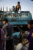 A young boy climbs on the water tanker while residents fill water from a Delhi Jal Board water tanker in the slums of Govind Puri in New Delhi, India. Photo: Sanjit Das for The Foreign Policy