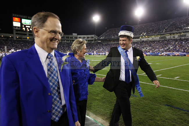 George Kington  walks out joking with Lee and Patsy Todd after being crowned king and queen during halftime of UK vs Georgia on Sat. Oct. 23, 2010. Photo by Britney McIntosh | Staff