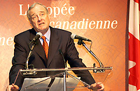 March 27. 2002, Montreal, Quebec, Canada; <br /> <br /> Paul Martin,Canada's Minister of Finance (and possible replacement to Liberal leaderJean Chretien)<br /> unveil The second bank note in the new Canadian<br /> Journeyl, March 27th, 2002  in Montreal, Canada.<br /> <br /> Guests including Jean B&raquo;liveau, former NHL hockey player for the Montr&raquo;al Canadiens,<br />  Kim St. Pierre, member of the gold-medal-winning<br /> Canadian Olympic women's hockey team in Salt Lake City,<br />  and Myriam B&raquo;dard, Olympic gold medallist in the biathlon <br /> where attending the event that took place early this morning at the AMC Pepsi Forum Cinemas (build onside the former Forum hockey rink).<br /> <br /> The new $5 note will be available at financial institutions across Canada at approximately 10:30 a.m., on Wednesday, 27 March 2002