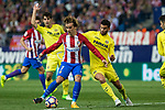 Antoine Griezmann of Atletico de Madrid holds off pressure from  Mussacchio of Villarreal during the match of La Liga between Atletico de Madrid and Villarreal at Vicente Calderon  Stadium  in Madrid, Spain. April 25, 2017. (ALTERPHOTOS/Rodrigo Jimenez)