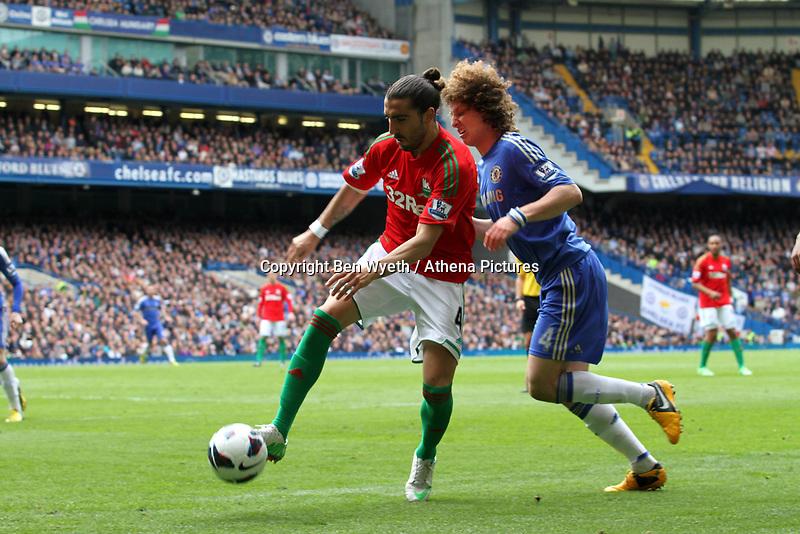 Pictured: Chico Flores goes past David Luiz<br /> Barclays Premier League, Chelsea FC (blue) V Swansea City,<br /> 28/04/13