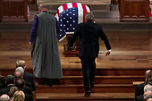 Former President George Bush walks towards the flag-draped casket of his father, former President George H.W. Bush, as he prepares to speak during his State Funeral at the National Cathedral, Wednesday, Dec. 5, 2018,  in Washington. <br /> Credit: Andrew Harnik / Pool via CNP