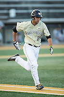 Justin Yurchak (20) of the Wake Forest Demon Deacons hustles down the first base line against the UConn Huskies at Wake Forest Baseball Park on March 17, 2015 in Winston-Salem, North Carolina.  The Demon Deacons defeated the Huskies 6-2.  (Brian Westerholt/Four Seam Images)