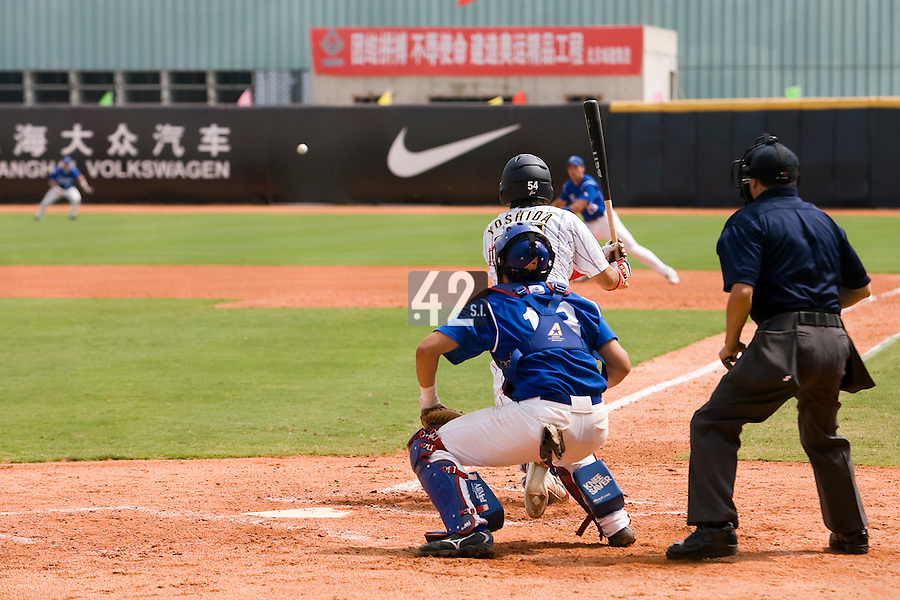 22 August 2007: First Base #54 Kei Yoshida connects with the ball during the Japan 9-4 victory over France in the Good Luck Beijing International baseball tournament (olympic test event) at west Beijng's Wukesong Baseball Field in Beijing, China.
