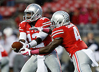 Ohio State Buckeyes quarterback Cardale Jones (12) hands off to running back Curtis Samuel (4) during the fourth quarter of the NCAA football game against the Rutgers Scarlet Knights at Ohio Stadium in Columbus on Oct. 18, 2014. (Adam Cairns / The Columbus Dispatch)