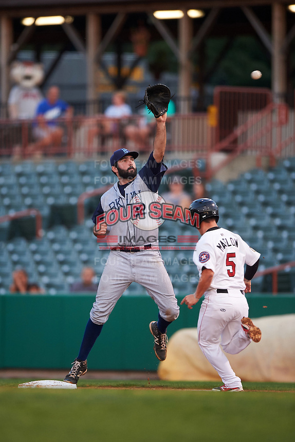 Brooklyn Cyclones first baseman Zach Mathieu (32) stretches for a throw as Brooks Marlow (5) runs through the bag during a game against the Tri-City ValleyCats on September 1, 2015 at Joseph L. Bruno Stadium in Troy, New York.  Tri-City defeated Brooklyn 5-4.  (Mike Janes/Four Seam Images)
