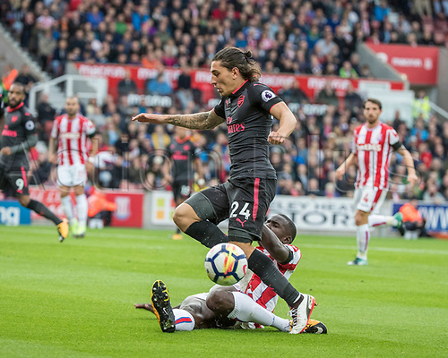 19th August 2017, bet365 Stadium, Stoke-on-Trent, England; EPL Premier League football, Stoke City versus Arsenal; Hector Bellerin of Arsenal straddles a challenge by Saido Berahino of Stoke City