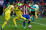 Samu Castillejo of Villarreal competes for the ball with Filipe Luis of Atletico de Madrid during the match of La Liga between Atletico de Madrid and Villarreal at Vicente Calderon  Stadium  in Madrid, Spain. April 25, 2017. (ALTERPHOTOS/Rodrigo Jimenez)