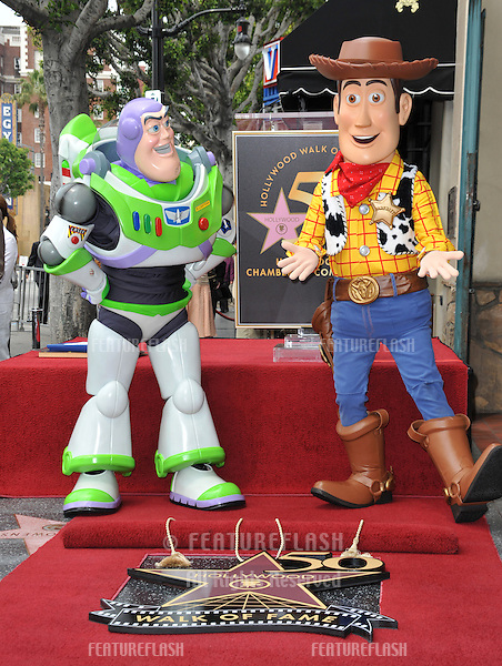 Toy Story stars Buzz Lightyear (left) & Woody on Hollywood Boulevard where composer Randy Newman was honored today with a star on the Hollywood Walk of Fame..June 2, 2010  Los Angeles, CA.Picture: Paul Smith / Featureflash