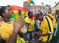 Germany, DEU, Dortmund, 2006-Jun-27: FIFA football world cup (USA: soccer world cup) 2006 in Germany; Ghanaian football fans making music at a public viewing zone on the Friedensplatz before the world cup match Brazil vs. Ghana (3:0).