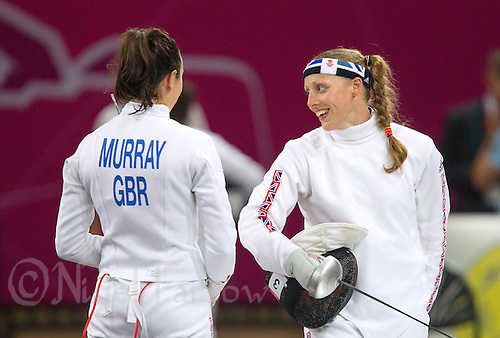 12 AUG 2012 - LONDON, GBR - Mhairi Spence (GBR) (right) of Great Britain talks with team mate Samantha Murray during the women's London 2012 Olympic Games Modern Pentathlon fencing at The Copper Box in the Olympic Park, in Stratford, London, Great Britain (PHOTO (C) 2012 NIGEL FARROW)