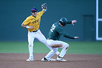 Bailey Peterson (22) of the Michigan State Spartans is safe as second baseman Alex Haba (5) of the Merrimack Warriors takes the throw in a game on Saturday, February 22, 2020, at Fluor Field at the West End in Greenville, South Carolina. Merrimack won, 7-5. (Tom Priddy/Four Seam Images)