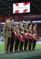 Members of the armed forces with Remembrance Day wreaths during the 2018 FIFA World Cup Qualifier between Wales and Serbia at the Cardiff City Stadium, Wales, UK. Saturday 12 November 2016