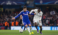 Cesc Fabregas of Chelsea holds off Blaise Matuidi of Paris Saint-Germain during the UEFA Champions League Round of 16 2nd leg match between Chelsea and PSG at Stamford Bridge, London, England on 9 March 2016. Photo by Andy Rowland.