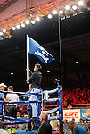 The Nevada flag is flown as Oscar Vasquez from Reno, NV enters the ring during the Rural Rumble on Friday night, August 8, 2014 at Churchill County Fairgrounds in Fallon, Nevada.
