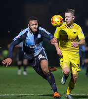 Aaron Amadi-Holloway of Wycombe Wanderers & Jordan Evans of Oxford United go for the ball during the Sky Bet League 2 match between Wycombe Wanderers and Oxford United at Adams Park, High Wycombe, England on 19 December 2015. Photo by Andy Rowland.