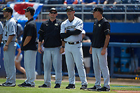 Wake Forest Demon Deacons volunteer assitant coach Joey Hammond (left), assistant coach Bill Cilento, and head coach Tom Walter prior to the game against the Florida Gators in Game One of the Gainesville Super Regional of the 2017 College World Series at Alfred McKethan Stadium at Perry Field on June 10, 2017 in Gainesville, Florida. The Gators defeated the Demon Deacons 2-1 in 11 innings. (Brian Westerholt/Four Seam Images)