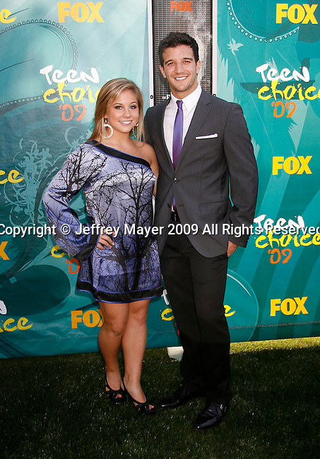 UNIVERSAL CITY, CA. - August 09: Olympic gold medalist Shawn Johnson and dancer Mark Ballas arrive at the Teen Choice Awards 2009 held at the Gibson Amphitheatre on August 9, 2009 in Universal City, California.
