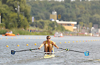 Poznan, POLAND,  SWE M1X,   Lassi KARONEN competing in the heats of the men's single scull, on the first day of the, 2009 FISA World Rowing Championships. held on the Malta Rowing lake, Sunday 23/08/2009 [Mandatory Credit. Peter Spurrier/Intersport Images]