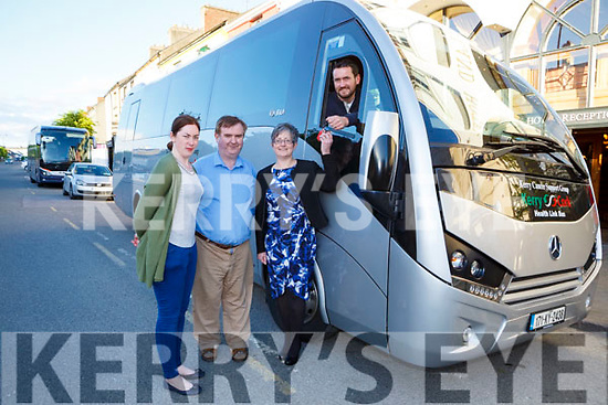 Tricia Kelly, Dan Horan and  Breda Dyland presents the keys  of the new Cork Kerry Health link bus to Paudie Collins  in Castleisland on Tuesday evening