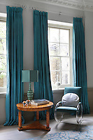 The master bedroom has soft accent colours and plays around a relaxing interaction of various layered blues