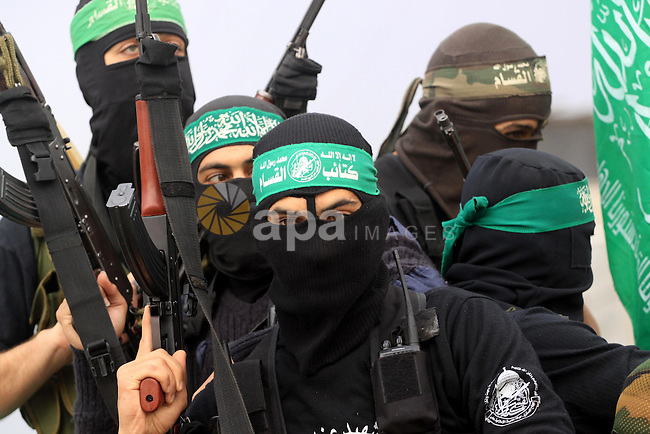 Members of Al-Qassam Brigades take part in a rally in the Eastern Gaza City on Dec 7,2009. Hamas movment announced the starting of the movement launch activities, from the Hamas founder home, Ahmed Yaseen in Gaza City on Dec 5,2009. Photo by Mohammed Asad