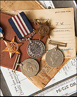 BNPS.co.uk (01202 558833)<br /> Pic: PhilYeomans/BNPS<br /> <br /> Sapper James Angel's WW2 medals and military documents- including a citation signed by Monty.<br /> <br /> A nine-year-old girl's school project has led her family to find her war hero great-grandfather's gallantry medal they knew nothing about.<br /> <br /> Elizabeth Turner asked her grandmother Sheila Scott for help with her homework on World War Two and was told about a late relative who fought in Europe.<br /> <br /> James Angel was a modest man who rarely spoke about his experiences of war, including<br /> winning the Military Medal for one incredibly heroic action.<br /> <br /> Sapper Angel put himself in the line of fire when Allied soldiers were pinned down by Germans as they tried to cross the Rhine in Germany in March 1945.<br /> <br /> With great risk to his own life, he drew enemy fire away from his comrades by engaging them with his Bren gun and allowed the British to locate and silence the Germans.<br /> <br /> It is believed that after the war Mr Angel sold his Military Medal to help provide for his seven children.<br /> <br /> His family knew he once had a 'special medal' but had no idea what it was or was for until Elizabeth began her school project two weeks ago.<br /> --