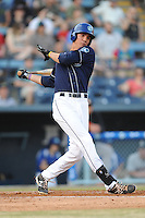 Asheville Tourists right fielder Jordan Patterson #10 swings at a pitch during opening night game against the Delmarva Shorebirds at McCormick Field on April 3, 2014 in Asheville, North Carolina. The Tourists defeated the Shorebirds 8-3. (Tony Farlow/Four Seam Images)