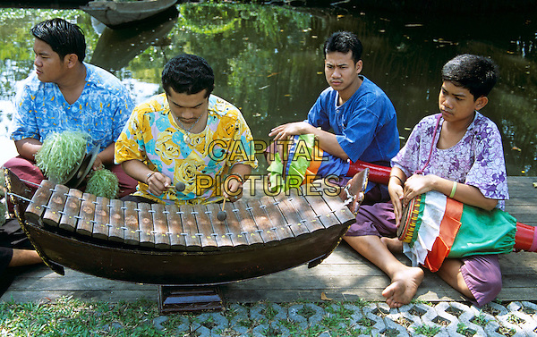 Quartet of musicians, Riverside Rose Garden, Sampran, Nakorn Pathom, near Bangkok, Thailand
