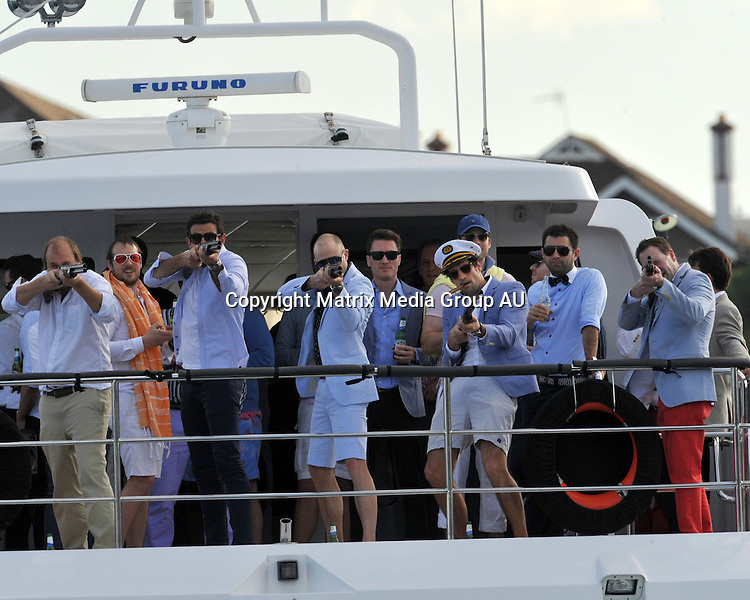 19 AUGUST 2013 SYDNEY AUSTRALIA<br /> <br /> EXCLUSIVE PICTURES<br /> <br /> Hamish Blake pictured with Andy Lee enjoying a day out on the harbour aboard 'AQA' with a bunch of friends for 'Wippas' bucks party. VIP guests included Lachlan Murdoch, Fitzy and a couple of strippers. The boys kicked off the festivities at Double Bay 18 footers club with lunch and drinks on the deck before heading out on the harbour for some a cruise which included laser skeet shooting and a drink service by a buxom lass in a gold bikini. The celebrations continued into the night as the party kicked on to the Tilbury.