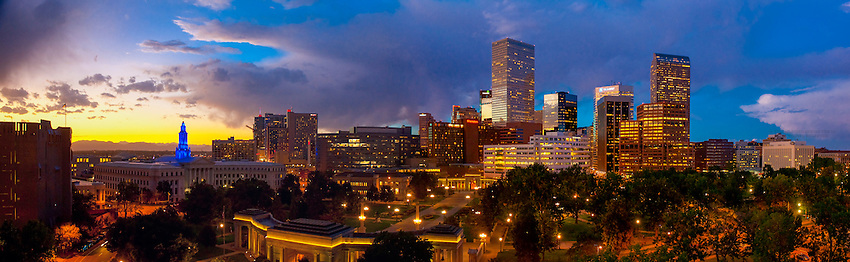 Panoramic view of downtown skyline with Denver Art Museum on left and  Denver Civic Center (City & County Bldg.) next to it and Civic Center Park in foreground,  Denver, Colorado USA.