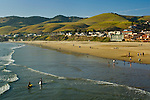 People wading in the surf at Pismo Beach, California