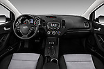 Stock photo of straight dashboard view of 2016 KIA Forte-Koup EX 2 Door Coupe Dashboard