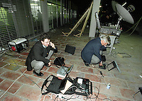 Norwegian journalists Halvard Helle (left) from Dagbladet newspaper and Fritz Nilsen from Norweigan Broadcasting Company (NRK) file stories outside a press center in Baghdad. They were covering the standoff in relation to UN weapons inspectors in 1998,  the UNSCOM weapons inspectors left Iraq later that year.