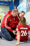 GER - Mannheim, Germany, December 19: During the 1. Bundesliga Sued Damen indoor hockey match between Mannheimer HC (blue) and Nuernberger HTC (red) on December 19, 2015 at Irma-Roechling-Halle in Mannheim, Germany. (Photo by Dirk Markgraf / www.265-images.com) *** Local caption *** I. Borgmann #26 of Nuernberger HTC receives medical attention
