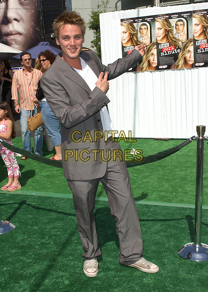 RIELY SMITH.Attending the world premiere of movie New York Minute at The Graumans's Chinease Theatre, Hollywood, California..May 1st 2004.full length full-length pinstripe suit scruffy tainers pointing gesture.*UK sales only*.www.capitalpictures.com.sales@capitalpictures.com.©Capital Pictures