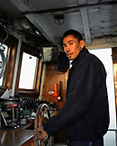 GREENLAND, Ilulissat, Disco Bay, portrait of captain and his boat