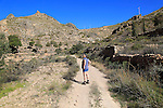 Woman walking in Sierra Alhamilla mountains, Nijar, Almeria, Spain