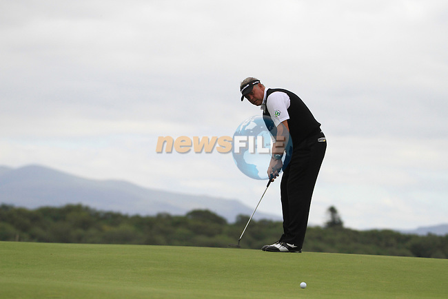 Darren Clarke (NIR) sinks his putt on the 10th green during Day 1 Thursday of The Irish Open presented by Discover Ireland at Killarney Golf & Fishing Club on 28th July 2011 (Photo Jenny Matthews/www.golffile.ie)
