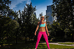 Young Woman posing and Exercising in Central Park, NYC on a beatufiul Summer day