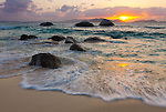 Virgin Gorda, British Virgin Islands, Caribbean<br /> Boulders awash in the surf of Little Trunk Bay near the Baths. Setting sun over Tortola across Sir Francis Drake Channel.