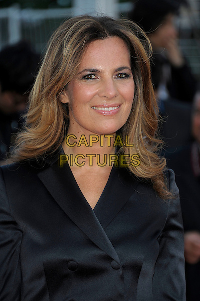 Roberta Armani.'Lawless' screening at the 65th  Cannes Film Festival, France 19th May 2012.portrait headshot smiling  black silk satin trousers suit jacket .CAP/PL.©Phil Loftus/Capital Pictures.