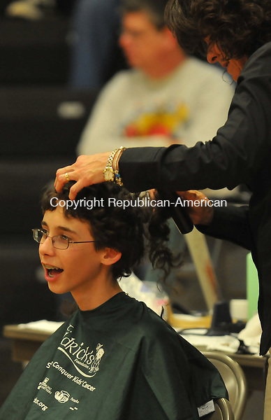 WATERTOWN, CT- 16 MARCH 2010 - 031501IP04- Adam Concepcion, 13, a student at Swift Middle School, gets his hair shaved off by Angela McIldowie of Angela's Hair Depot in Watertown, during a fundraiser  for St. Baldrick's Foundation which raises money for pediatric cancer research, at Watertown High School on Tuesday. High School and middle school students in Watertown collected donations to shave their heads to show solidarity with cancer patients.<br /> Irena Pastorello Republican-American