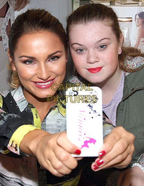 CORBY, ENGLAND - NOVEMBER 29: Samantha Faiers signing gift sets of her bestselling fragrance 'La Bella' at Tesco Extra, on November 29, 2014 in Corby, England<br /> CAP/ROS<br /> &copy;Steve Ross/Capital Pictures