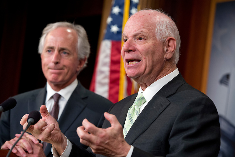 UNITED STATES - MAY 7: Sens. Bob Corker, R-Tenn., left, and Ben Cardin, D-Md., conduct a news conference in the Capitol's Senate studio after the Senate passed the Iran Nuclear Review Act, May 7, 2015. (Photo By Tom Williams/CQ Roll Call)