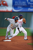 Cedar Rapids Kernels shortstop Nick Gordon (5) throws to first as Victor Reyes (5) slides into second during a game against the Kane County Cougars on August 18, 2015 at Perfect Game Field in Cedar Rapids, Iowa.  Kane County defeated Cedar Rapids 1-0.  (Mike Janes/Four Seam Images)