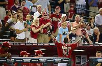 Jun. 20, 2012; Phoenix, AZ, USA; Arizona Diamondbacks third baseman Ryan Roberts answers the curtain call from the fans after hitting a two run inside the park home run in the sixth inning against the Seattle Mariners at Chase Field.  Mandatory Credit: Mark J. Rebilas-