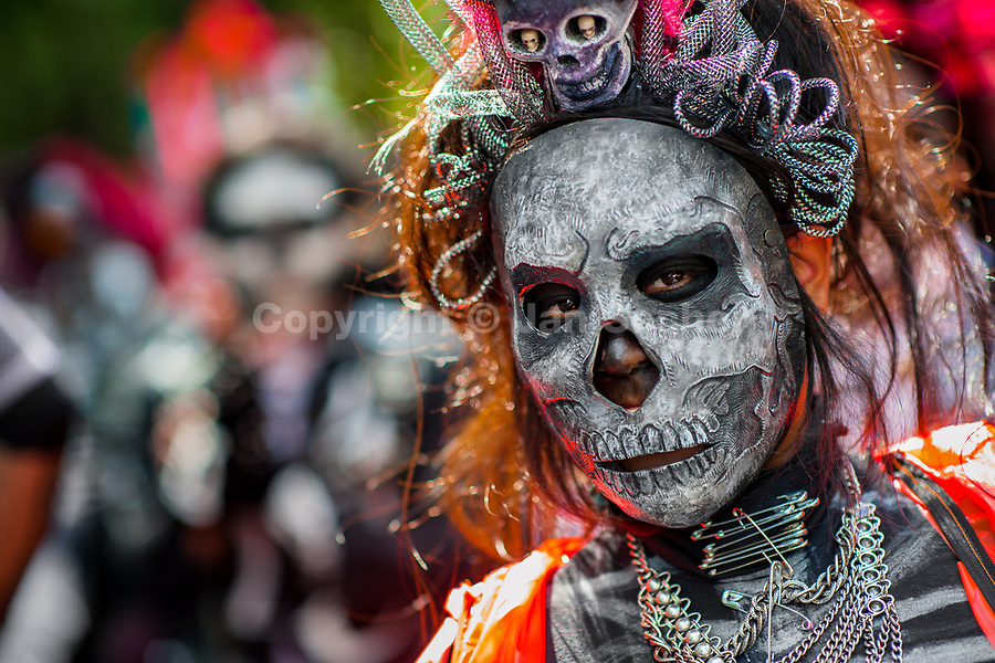A young woman, dressed as La Catrina, a Mexican pop culture icon representing the Death, takes part in the Day of the Dead festival in Mexico City, Mexico, 29 October 2016. Day of the Dead (Día de Muertos), a syncretic religious holiday combining the death veneration rituals of the ancient Aztec culture with the Catholic practice, is celebrated throughout all Mexico. Based on the belief that the souls of the departed may come back to this world on that day, people gather at the gravesites in cemeteries praying, drinking and playing music, to joyfully remember friends or family members who have died and to support their souls on the spiritual journey.