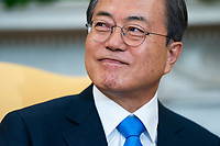 Korean President Moon Jae-in listens to US President Donald J. Trump (not pictured) speak in the Oval Office of the White House in Washington, DC, USA, 11 April 2019. President Moon is expected to ask President Trump to reduce sanctions on North Korea in an attempt to jump start nuclear negotiations between North Korea and the US.<br /> Credit: Jim LoScalzo / Pool via CNP/AdMedia
